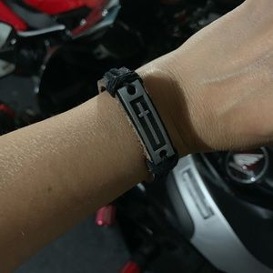 Authentic leather wristband w/metal charm